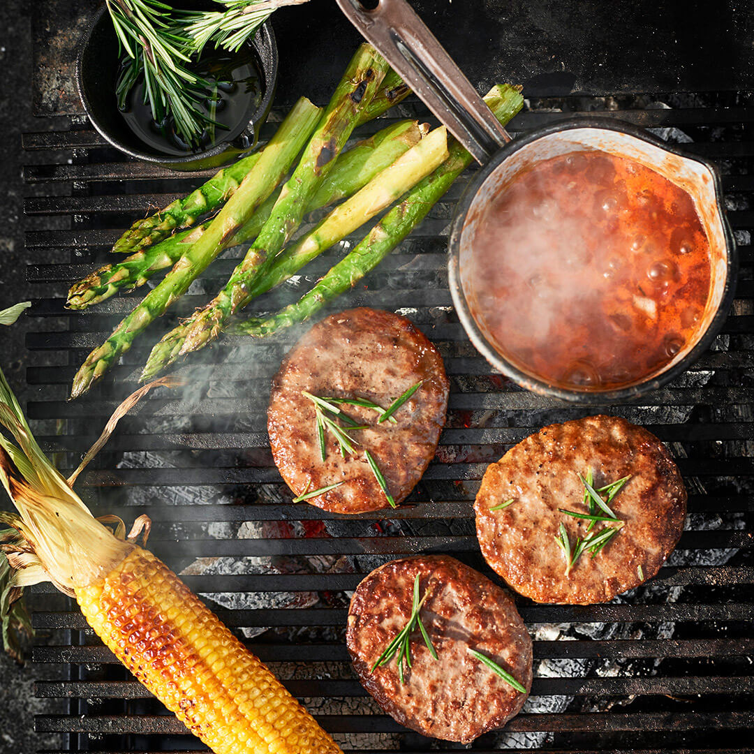 BBQ rosemary Iberico Burgers, hot salsa, asparagus and corn