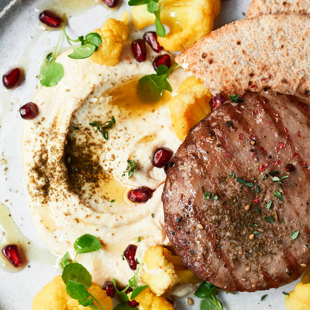 Lamb Burger with hummus, pickled cauliflower, pomegranate and Za'atar